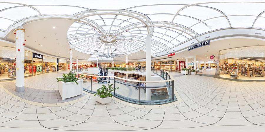Customers go down the escalator in the shopping centre Wilenska