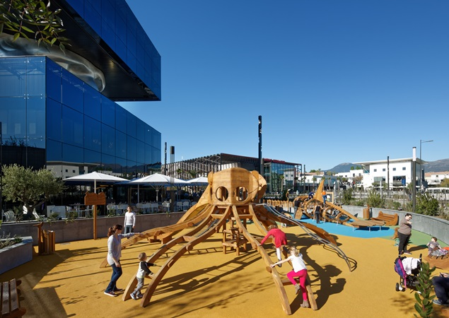 Kids play at a playground in Polygone Riveria.